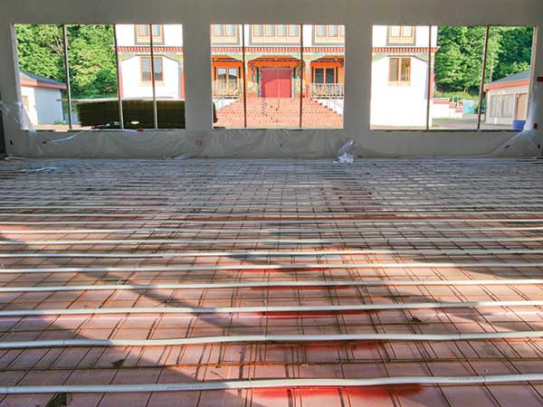 Radiant heating tubing before concrete